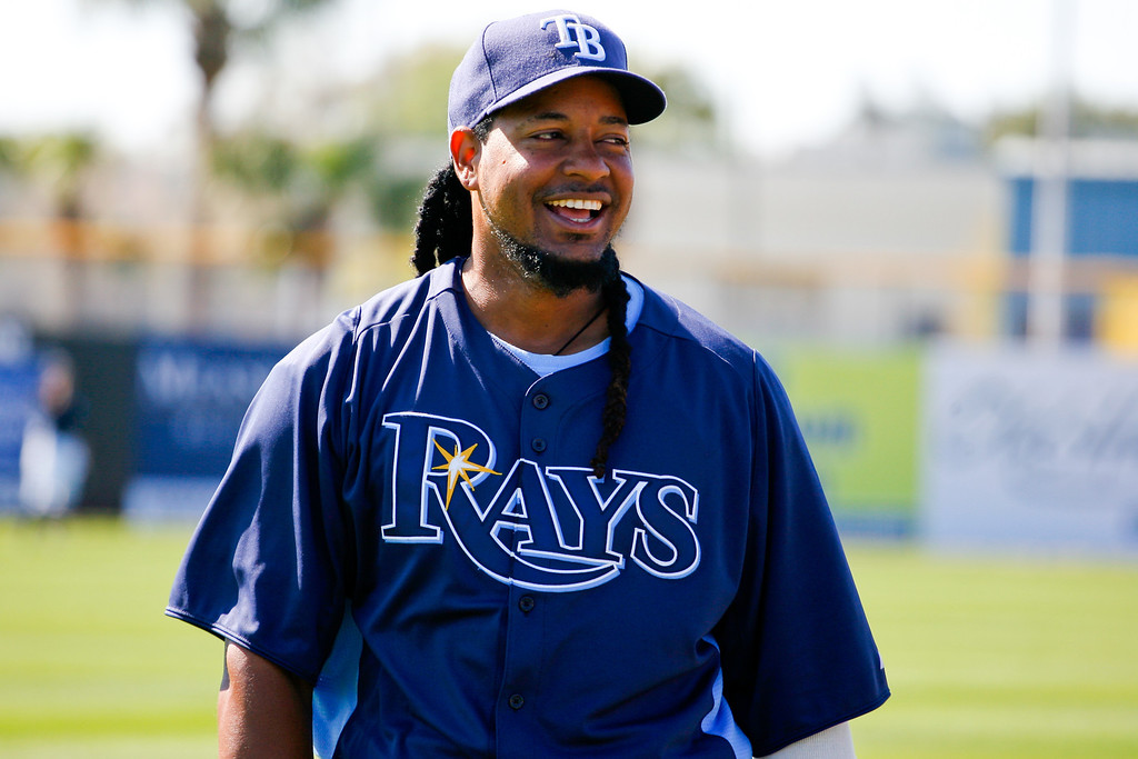Tampa Bay Rays left fielder Manny Ramirez (24) laughs with teammates prior to a Grapefruit League Spring Training Game at the Florida Auto Exchange Stadium.