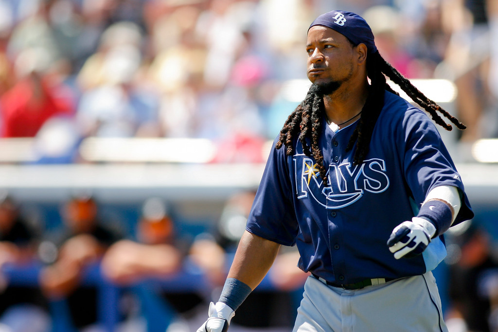Tampa Bay Rays left fielder Manny Ramirez (24) walks off the field after being struck out during a Grapefruit League Spring Training Game at the Florida Auto Exchange Stadium.