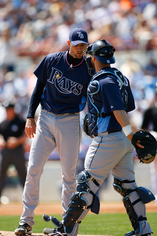 Tampa Bay Rays relief pitcher Chris Bootcheck (78) and Tampa Bay Rays catcher Kelly Shoppach (10) talk on the mound during a Grapefruit League Spring Training Game at the Florida Auto Exchange Stadium.