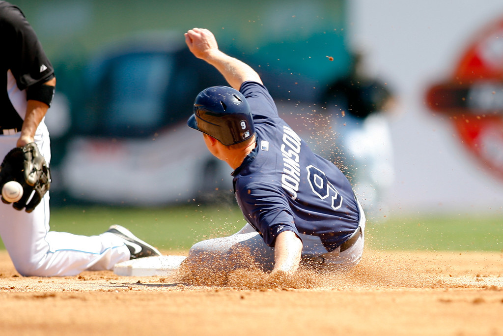 Tampa Bay Rays second baseman Elliot Johnson (9) slide into second base during a Grapefruit League Spring Training Game at the Florida Auto Exchange Stadium.