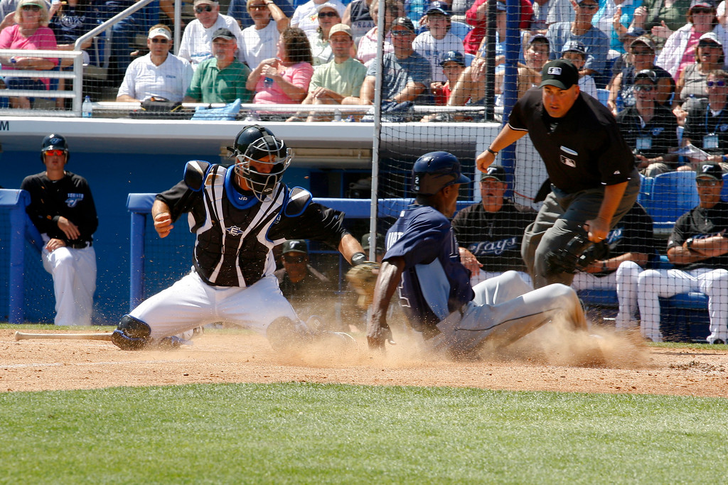 Tampa Bay Rays center fielder B.J. Upton (2) safely slide into home plate during a Grapefruit League Spring Training Game at the Florida Auto Exchange Stadium.