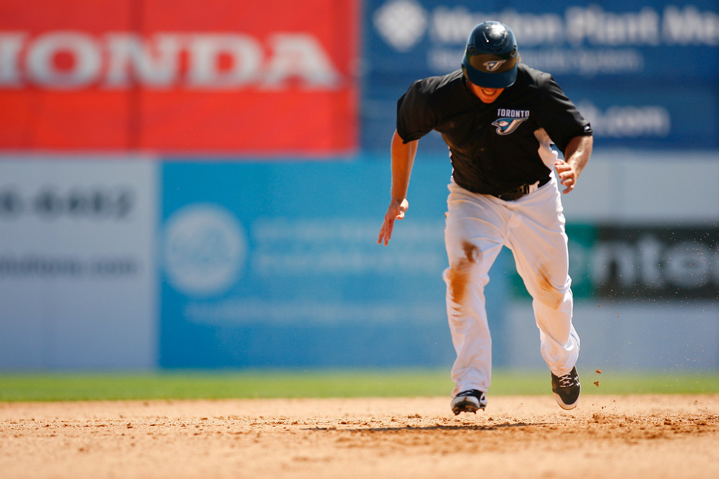 Toronto Blue Jays right fielder Travis Snider (45) runs for third base during a Grapefruit League Spring Training Game at the Florida Auto Exchange Stadium.
