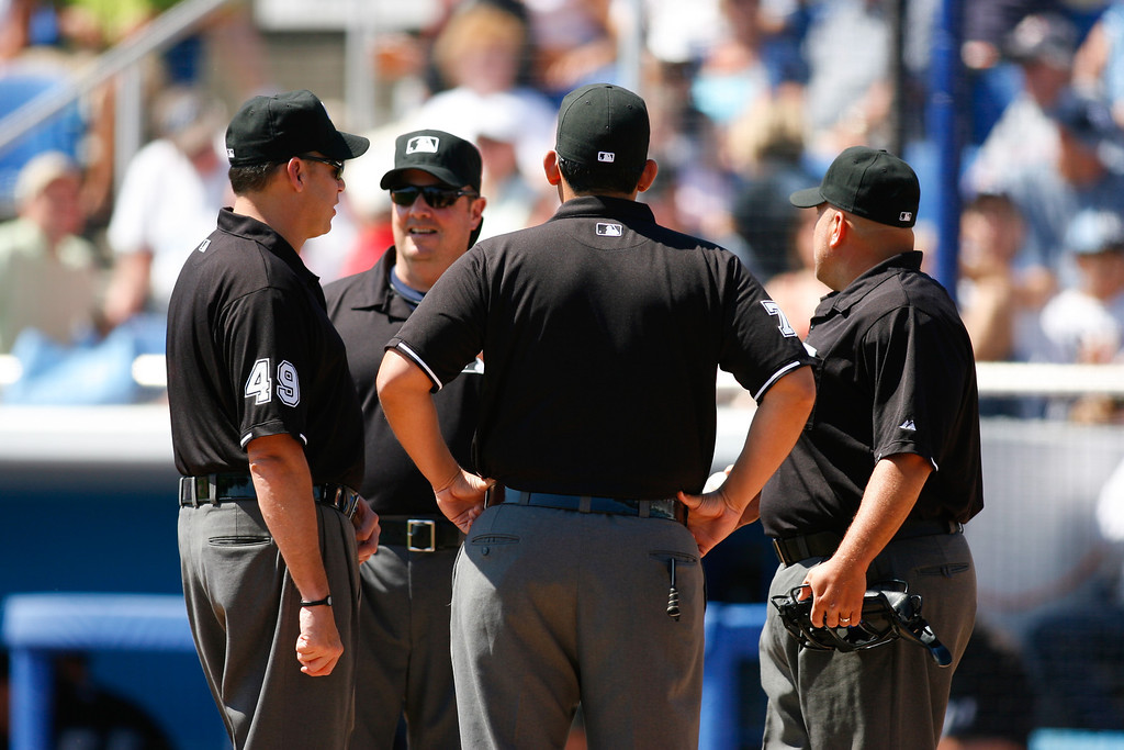 Umpires meet before a Grapefruit League Spring Training Game at the Florida Auto Exchange Stadium.