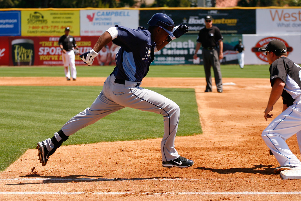 Tampa Bay Rays shortstop Tim Beckham (64) lunges for first base during a Grapefruit League Spring Training Game at the Florida Auto Exchange Stadium.