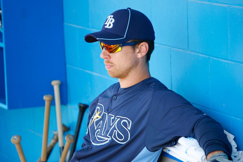 Tampa Bay Rays right fielder Ben Zobrist (18) rests in the dugout prior to a Grapefruit League Spring Training Game at the Florida Auto Exchange Stadium.