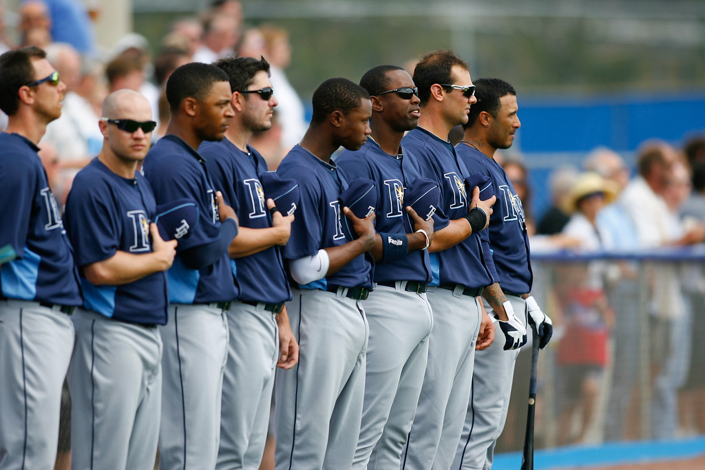 Tampa Bay Rays players stand during the National Anthem during a Grapefruit League Spring Training Game at the Florida Auto Exchange Stadium.