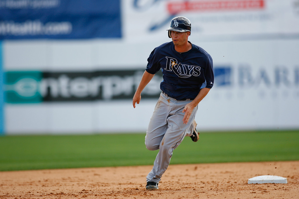 Tampa Bay Rays second baseman Reid Brignac (15) runs for third base during a Grapefruit League Spring Training Game at the Florida Auto Exchange Stadium. The Toronto Blue Jays beat Tampa Bay Rays 5-4.