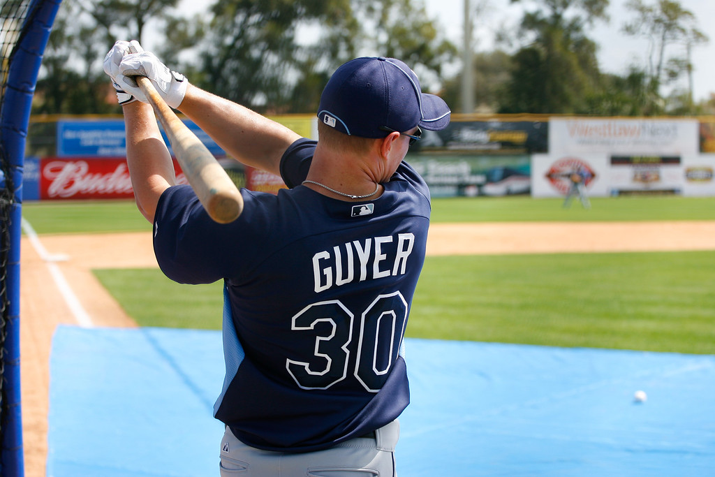 Tampa Bay Rays right fielder Brandon Guyer (30) hits during batting practice at a Grapefruit League Spring Training Game at the Florida Auto Exchange Stadium.