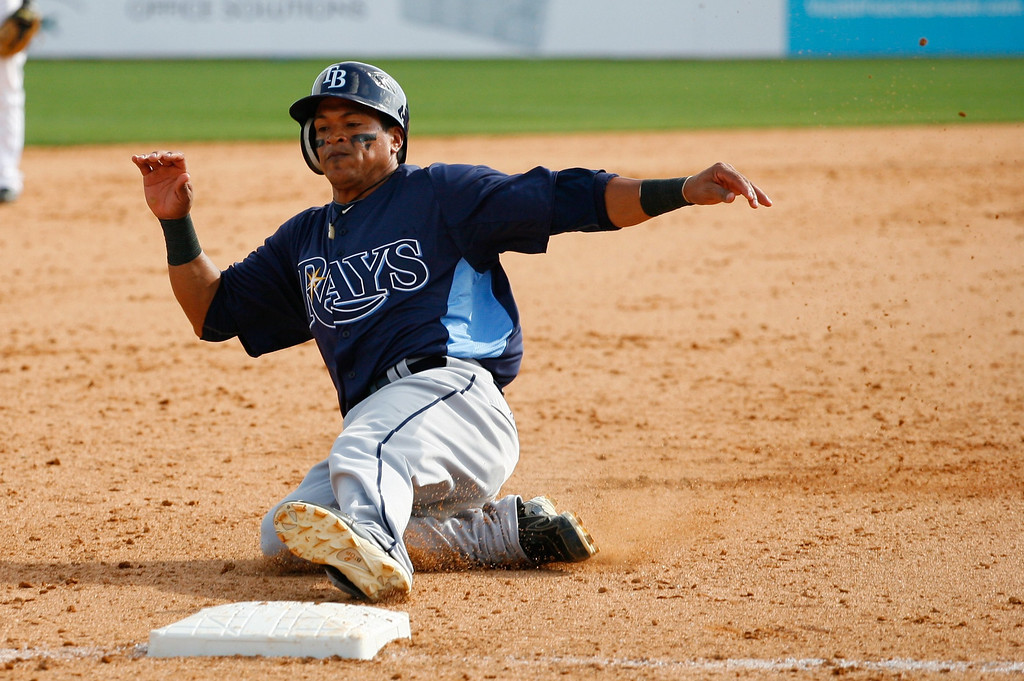 Tampa Bay Rays infielder Ray Olmedo (16) slides into third base during a Grapefruit League Spring Training Game at the Florida Auto Exchange Stadium. The Toronto Blue Jays beat the Tampa Bay Rays 5-4.