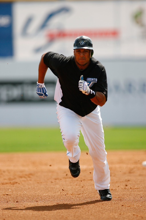 Toronto Blue Jays left fielder Juan Rivera (20) runs for third base during a Grapefruit League Spring Training Game at the Florida Auto Exchange Stadium.