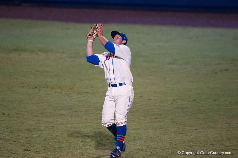 Florida senior Preston Tucker  catches a fly ball during the Gators' 5-3 loss against the Georgia Bulldogs Saturday April 21, 2012 at the McKethan Stadium in Gainesville, Fla. / Gator Country photo by Saj Guevara
