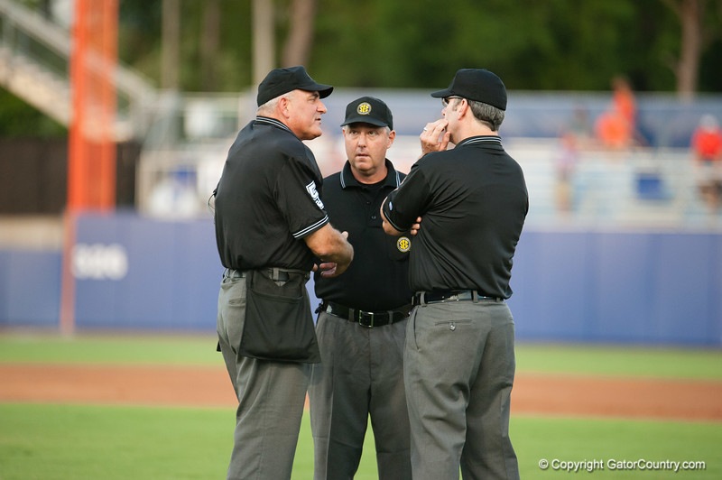 Umpires discussing a call during the Gators' 4-1 win against the Mississippi State Bullgods Friday May 11, 2012 at the McKethan Stadium in Gainesville, Fla. / Gator Country photo by Saj Guevara
