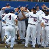 Players celebrate after a two-run error during the Gators' game against North Carolina State in Game 1 of the Gainesville Super Regional in McKethan Stadium on June 9, 2012.