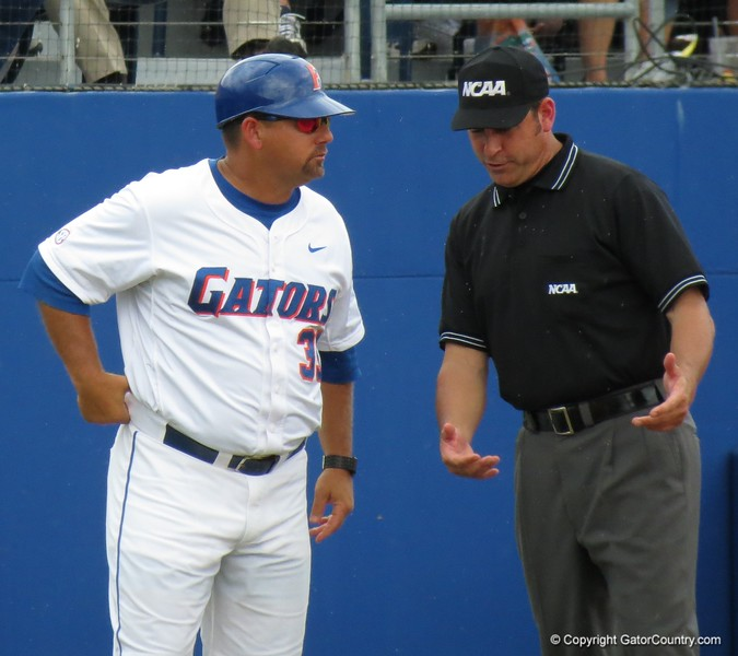UF third base coach Craig Bell talks with umpire Billy Haze in the Gators' game against North Carolina State in Game 1 of the Gainesville Super Regional in McKethan Stadium on June 9, 2012.