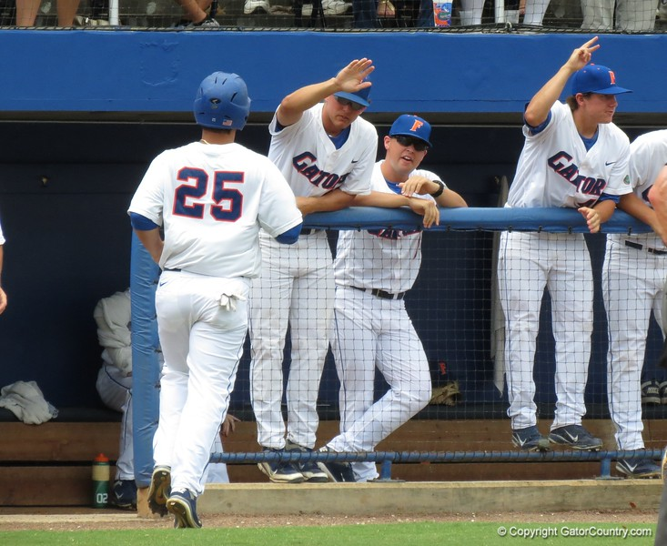 Florida's Preston Tucker (25) after scoring in the third inning of the Gators' game against North Carolina State in Game 1 of the Gainesville Super Regional in McKethan Stadium on June 9, 2012.