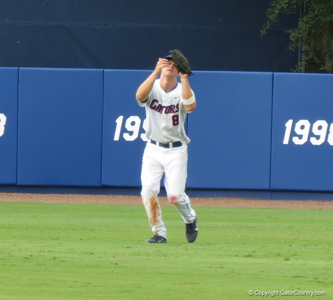 Florida center fielder Daniel Pigott catches a popup during the Gators' game against North Carolina State in Game 1 of the Gainesville Super Regional in McKethan Stadium on June 9, 2012.