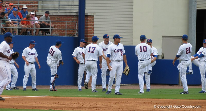 Florida's reserves stretch between innings in the Gators' game against North Carolina State in Game 1 of the Gainesville Super Regional in McKethan Stadium on June 9, 2012.