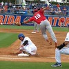 Florida's Brian Johnson slides back into first as the ball gets away during the Gators' game against North Carolina State in Game 1 of the Gainesville Super Regional in McKethan Stadium on June 9, 2012.