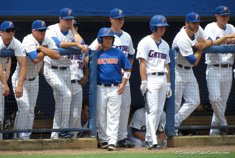 Florida players eye NC State's pitcher during the Gators' game against North Carolina State in Game 1 of the Gainesville Super Regional in McKethan Stadium on June 9, 2012.