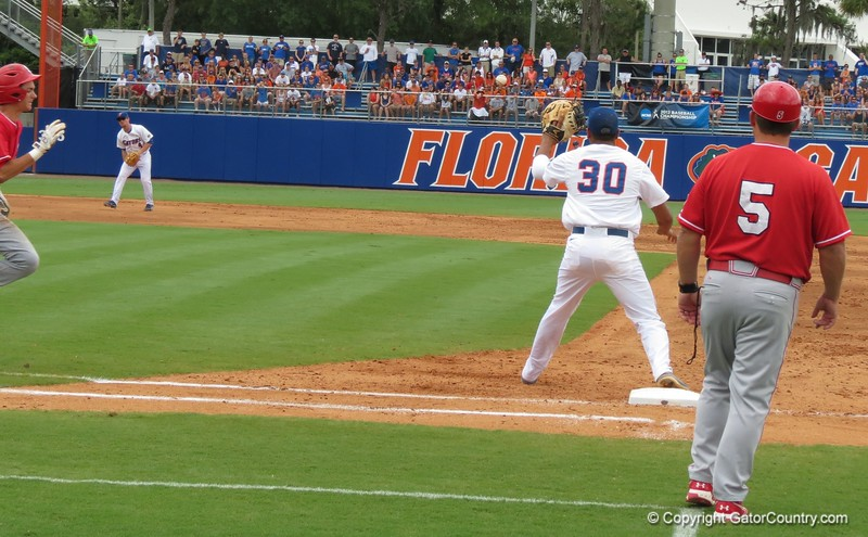 Florida's Vickash Ramjit (30) catches a throw from Josh Tobias for an out in the Gators' game against North Carolina State in Game 1 of the Gainesville Super Regional in McKethan Stadium on June 9, 2012.