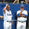Florida coaches Kevin O'Sullivan, left, and Craig Bell during the Gators' game against North Carolina State in Game 1 of the Gainesville Super Regional in McKethan Stadium on June 9, 2012.