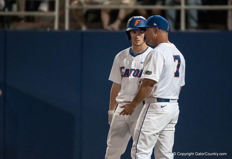 Florida freshman Casey Turgeon talks to coach Kevin O'Sullivan during the Gators' 9-2 win against the FSU Seminoles on Tuesday, March 13, 2012 at the McKethan Stadium in Gainesville, Fla. / Gator Country photo by Saj Guevara