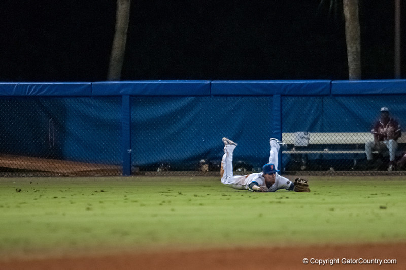 Florida senior Tyler Thompson catches a fly ball during the Gators' 9-2 win against the FSU Seminoles on Tuesday, March 13, 2012 at the McKethan Stadium in Gainesville, Fla. / Gator Country photo by Saj Guevara
