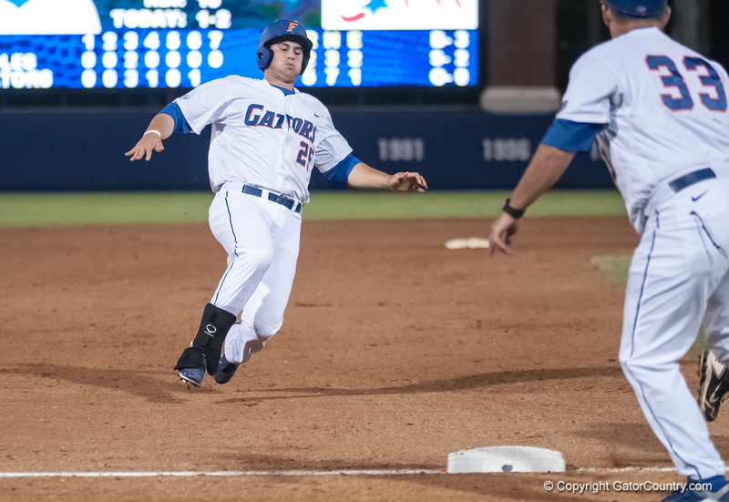Florida senior Preston Tucker slides to 3rd base during the Gators' 9-2 win against the FSU Seminoles on Tuesday, March 13, 2012 at the McKethan Stadium in Gainesville, Fla. / Gator Country photo by Saj Guevara