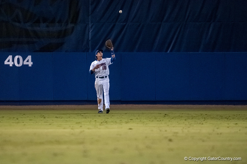 Florida senior Tyler Thompson catches the last fly ball of the game during the Gators' 9-2 win against the FSU Seminoles on Tuesday, March 13, 2012 at the McKethan Stadium in Gainesville, Fla. / Gator Country photo by Saj Guevara