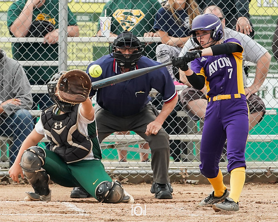 Avon Jessie Dean looks to put the softball in play against Amherst, Amherst Kylee McGraw catching. Tuesday April 16.  photo Joe Colon