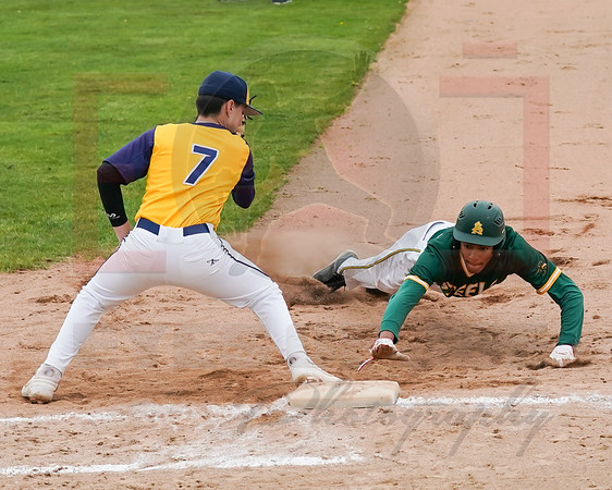 Amherst TJ Stanton dives back safely as O. Falls Tyler Urban looks to apply the tag Tuesday May 21.  photo Joe Colon
