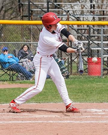 Elyria Evan Engle delivers a base hit against the Lorain Titans Saturday April 13.  photo Joe Colon