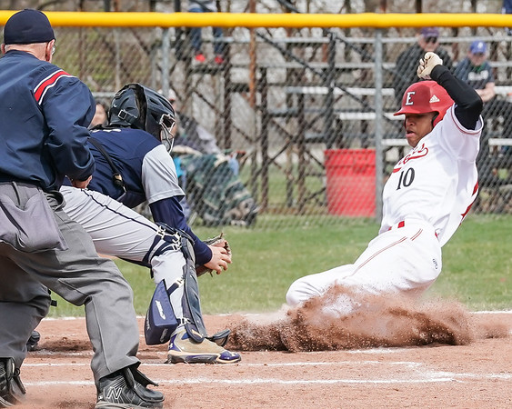 Elyria Stephen Larkins slides safely under the tag of Lorain catcher Cory Thompson Saturday April 13. photo Joe Colon
