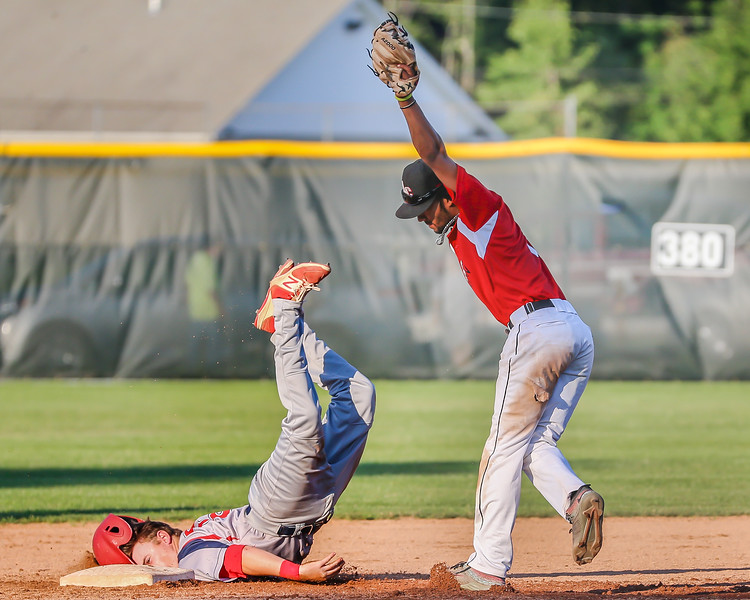 Ironmen shortstop Antonio Bennett makes the tag for the out against the Licking County Settlers Thursday July 27. photo Joe Colon
