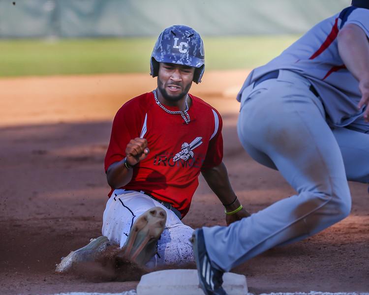 Ironmen Antonio Bennett steals third base against the Licking County Settler Thursday July 27. photo Joe Colon