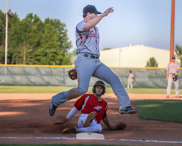 Ironmen Chase Knodle slide in safely after stealing third base against the Licking Settlers Thursday July 27. photo Joe Colon