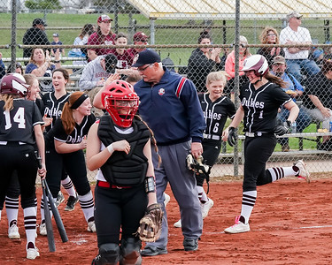 Wellington Kennedi Benko is greeted by her teamates after hitting a homerun against Brookside Wednesday April 17.  photo Joe Colon