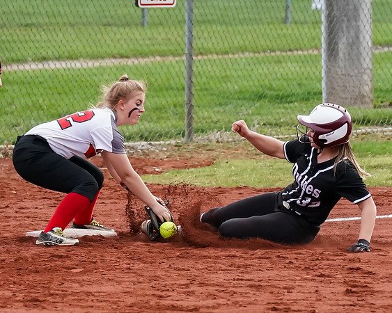 Wellington Brooke Noss is safe as Brookside McKayla Collins can't handle the throw Wednesday April 17.  photo Joe Colon