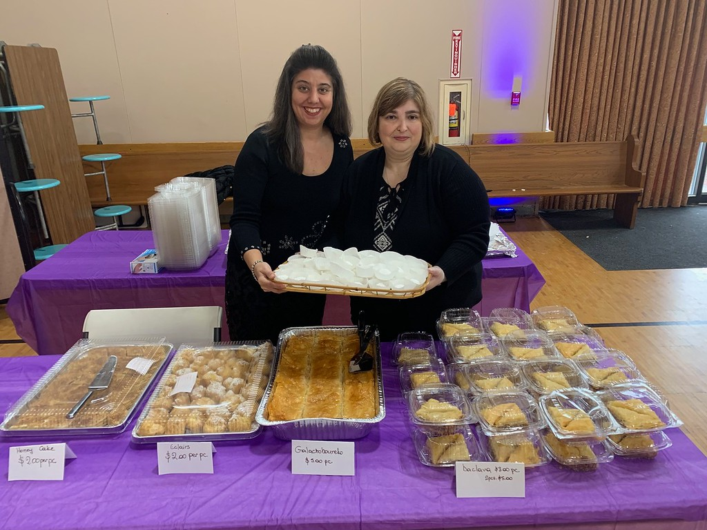 . HAA PTA members Meridith Regan of Ashby and Maria Booras of Lowell display delicious Greek pastries.