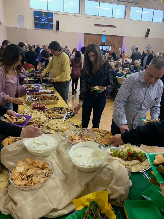 . Guests line up for delicious Greek food.