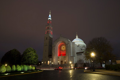 National Shrine exterior lit in red at night