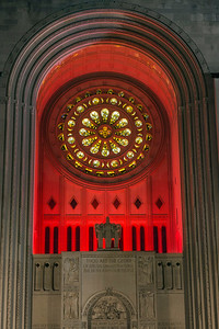 National Shrine exterior rose window lit in red at night