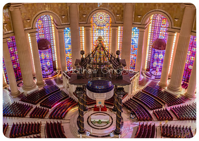Aerial view of the high altar and canopy, and the two minor altars/chapels one on either side behind the main altar of the Basilica of Our Lady of Peace Yamoussoukro Ivory Coast Cote d'Ivoire. Stained glass windows and Iroko wood pews. Columns of varying sizes.