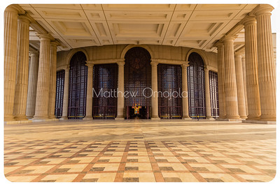 Porch and main entrance of the Basilica of Our Lady of Peace , Basilique Notre Dame de la Paix, Yamoussoukro Ivory Coast , Côte d'Ivoire. Many columns. Large windows and doors.