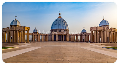 Front facade with major and minor domes  of the basilica and the colonnades of the Basilica of Our Lady of Peace (Basilique Notre Dame de la Paix) Yamoussoukro Ivory Coast, Cote d'Ivoire.