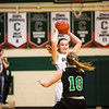 Clare's Peyton Hubel (10) looks to pass the ball over Houghton Lake's Alexis Souder (10) Thursday, Jan. 5, 2017. (PHOTOS BY KEN KADWELL -- FOR MIPREPZONE.COM).