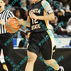 Wichita State Jessica Diamond (12) brings the ball down the court to the offense started against N. Iowa in the first half of the semifinal MVC tournament game.  At halftime Wichita State was trailing N. Iowa 27-23.