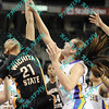 Wichita State Haleigh Lankster (21) and N. Iowa Amber Kirschbaum (10) battle for a rebound during the first half of the semifinal MVC tournament game.  At half time N, Iowa was leading Wichita State 27-23.