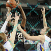Wichita State Breanna Dawkins (22) puts a shot up over the defense of Amber Kirschbaum (10) and Jacqui Kalin (0) both of N. Iowa during the first half of the semifinal MVC tournament game.  At halftime N. Iowa was leading Wichita State 27-23.