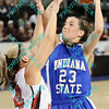 Indiana State Taylor Whitley (23) drives through Illinois State Amanda Clifton (14) putting up a shot late in the first half of their second round MVC tournament game.  At halftime Indiana State was leading Illinois State 38-19.